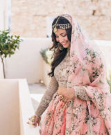 Indian bride with a pink wedding saree for her destination wedding in Rhodes Greece