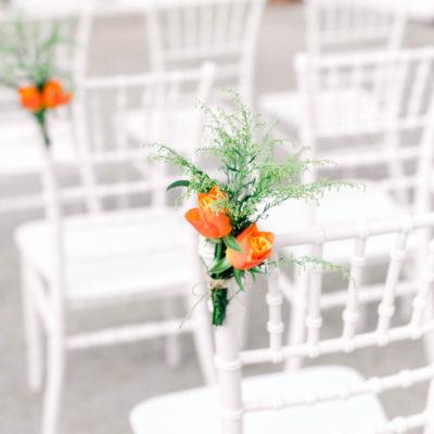 orange wedding flower chair decorations - Destination wedding in Greece - Wedding Planner in Rhodes -