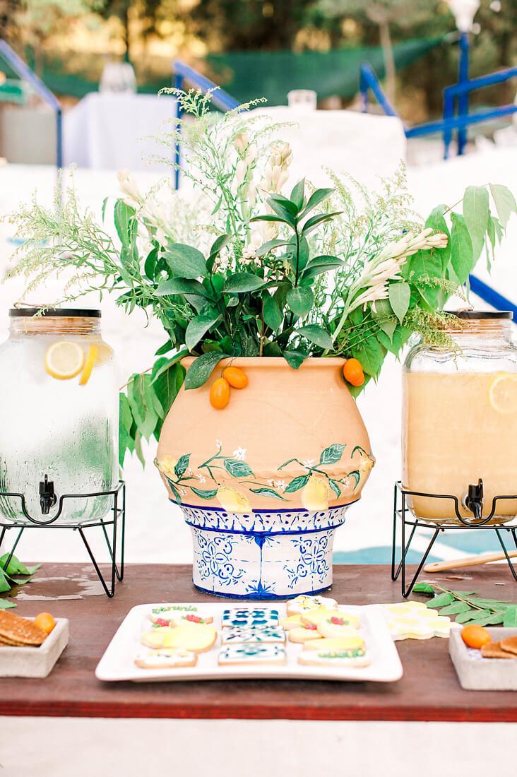 Mediterranean wedding flower arrangements with kumquats in ceramic pots by destination wedding planners in Rhodes