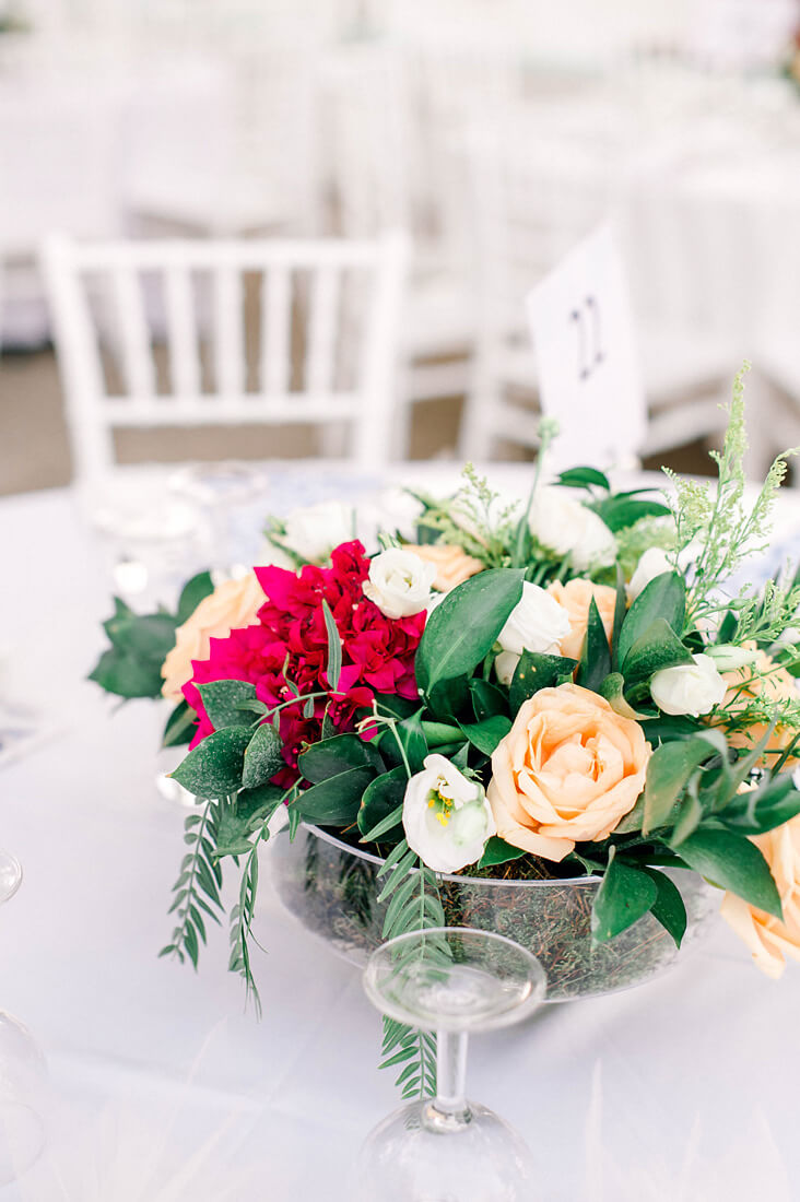 Destination wedding in Greece - Wedding Planner in Rhodes - bougainvillea and white roses wedding flower arrangements by eventions