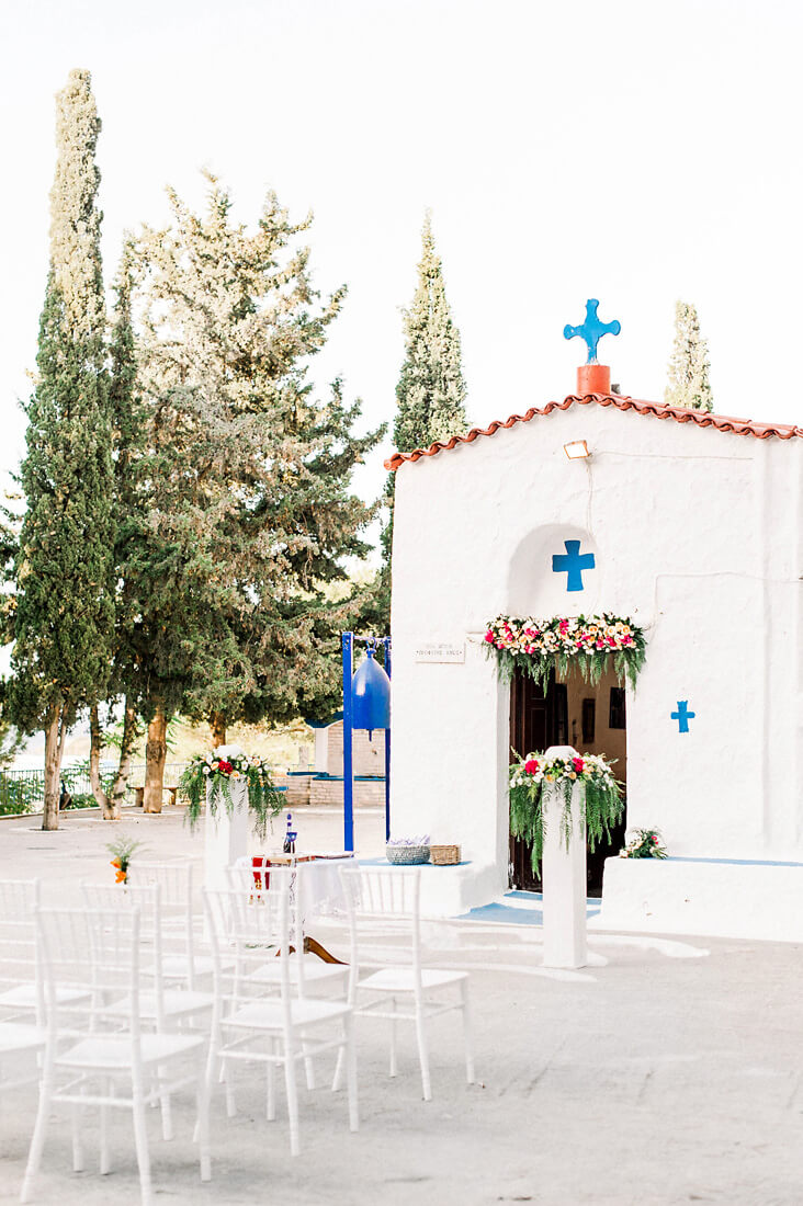 Destination wedding in Greece - Wedding Planner in Rhodes - white chapel wedding in greece decorated with bougainvilleas for a wedding