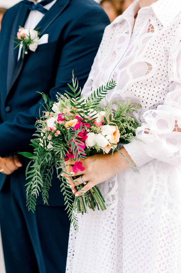 Destination wedding in Greece - Wedding Planner in Rhodes - bride holding her modern summer wedding flowers