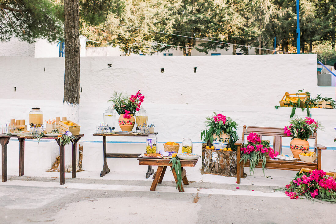 Destination wedding in Greece - Wedding Planner in Rhodes - dessert table and lemonade stand with lemon and bougainvillea decorations by eventions