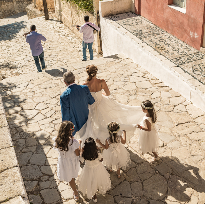 bride going to thechurch with her father and musical instruments