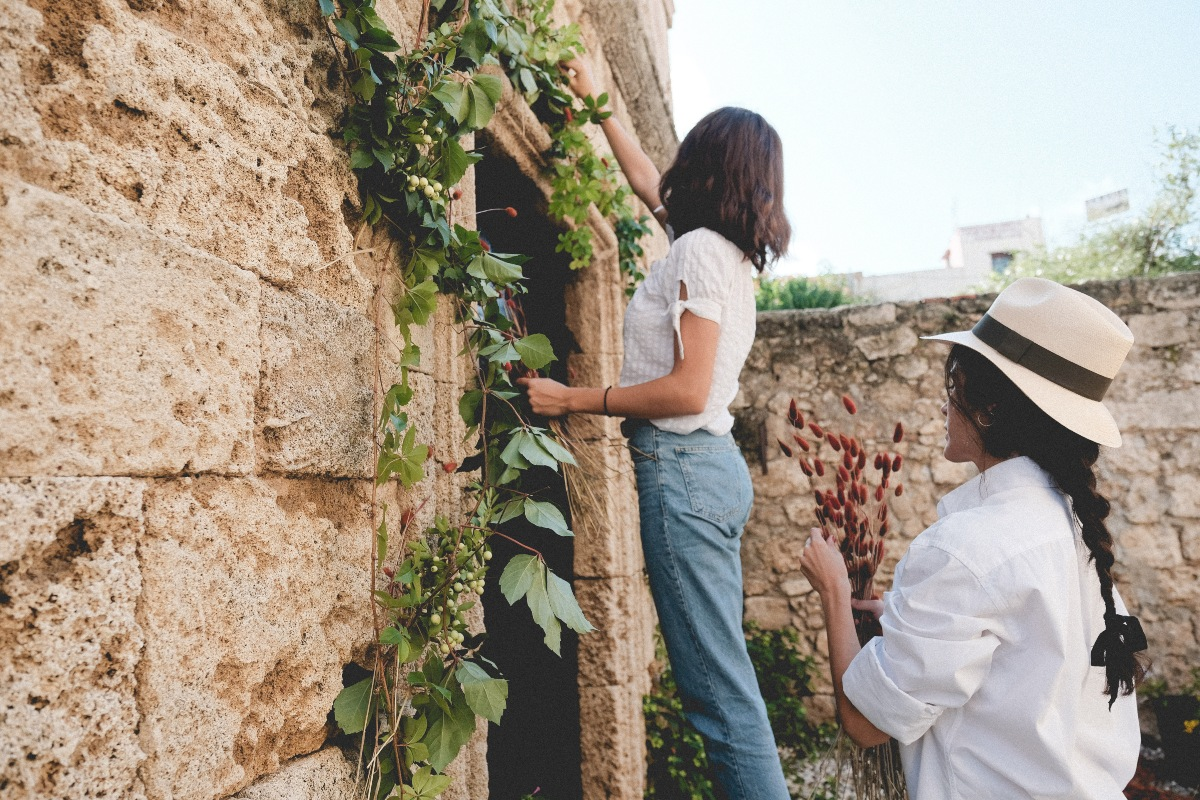 wedding planner in Rhodes - the eventions team decorating for a Mediterranean wedding