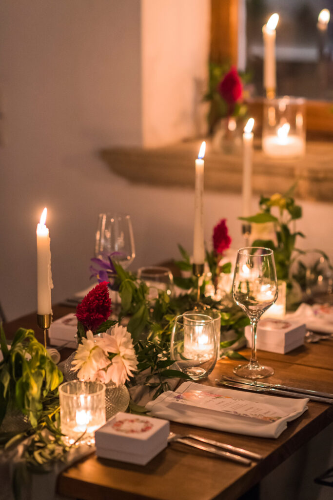 intimate and candlelit destination wedding dinner setting in greece